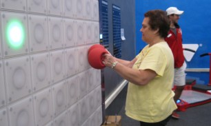 Member Evelyn Stier using the T-Wall