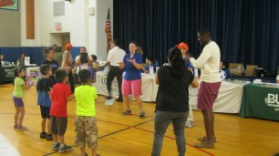 Open Door Family Medical Center volunteers lead Recess Rocks, a physical activity program for youth.