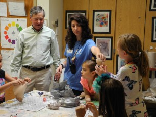NYS Assemblyman Steve Otis visits with camp counselor Jennifer Cacciola and members of her group during a recent visit to the Rye Y's summer camp.