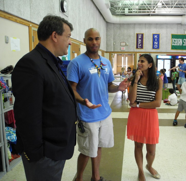 Latimer is shown above with John Rice, Rye Y Camp, Family and Teen Director and Board Member Uma Khemlani.